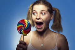 Happy girl with lollipop Stock Photos