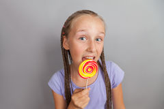 Happy girl with lollipop Royalty Free Stock Image
