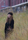 Happy girl in the autumn. Happy girl with long curly hair royalty free stock images