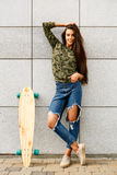Happy girl with longboard skateboard Stock Photo