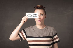 Happy girl looking with hand drawn paper eye glasses Royalty Free Stock Photography