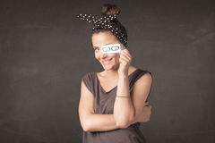Happy girl looking with hand drawn paper eye glasses Stock Photos