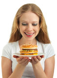 Happy girl looks at  fast food, hamburger Royalty Free Stock Photography