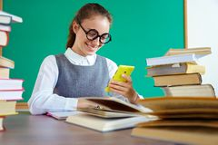 Happy girl looks at the phone and reads the message. stock photos