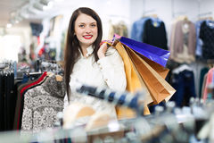 Happy girl  with a lot of shopping bags Stock Photos