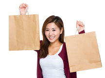 Happy girl with lots of shopping bag Royalty Free Stock Images