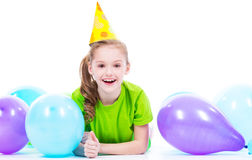 Happy girl  lying on the floor with colorful balloons. Stock Photo