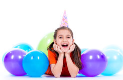 Happy girl  lying on the floor with colorful balloons. Stock Photography