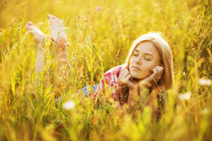 Happy girl lying in grass Royalty Free Stock Photo