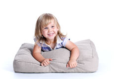 Happy girl lying on the grey pillow Stock Photo