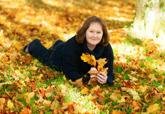 Happy girl lying on the ground in park Royalty Free Stock Photography
