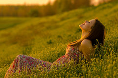 Happy girl lying on the meadow Royalty Free Stock Photos