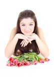 Happy girl lying with pink tulips Royalty Free Stock Images