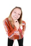 Happy girl with magnifier Stock Images