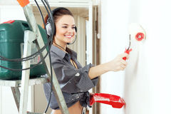 Happy girl  makes repairs at home Royalty Free Stock Photos