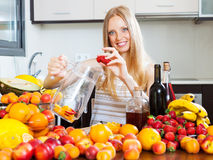 Happy girl making alcoholic cocktail Stock Image