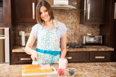 Happy girl making a cake at home Stock Photo