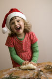 Happy girl making Christmas cookies Stock Images