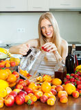 Happy girl making fruits beverages with alcohol Royalty Free Stock Image