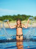 Happy girl making water splashes Royalty Free Stock Photography