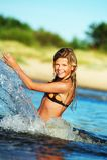 Happy girl making water splashes Royalty Free Stock Image