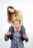 Happy girl on mans shoulders Royalty Free Stock Image