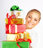 Happy girl with many gifts Royalty Free Stock Photography