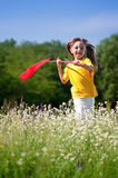 Happy girl on meadow Stock Photos