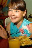 Happy girl at the meal. Stock Images