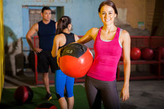 Happy girl with medicine ball Stock Photos