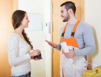 Happy girl meeting workman Stock Photos