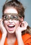 Happy girl with metallic chain Stock Image