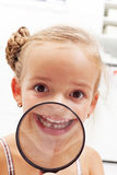 Happy girl with missing milk tooth Royalty Free Stock Photo