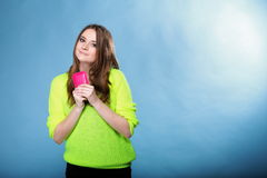 Happy girl with mobile phone in pink cover Stock Image