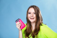 Happy girl with mobile phone in pink cover Stock Photo