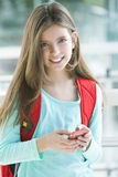 Happy girl with mobile phone. Sending text message Stock Photo