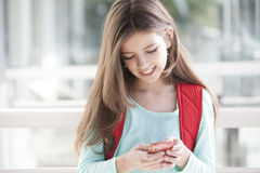 Happy girl with mobile phone. Sending text message Stock Images