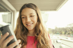 Happy girl with mobile phone. Happy girl smiling with mobile phone Royalty Free Stock Image