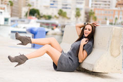 Happy girl model of fashion with high heels sitting on the floor Stock Photography