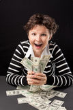 Happy girl with money Stock Photography