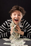 Happy girl with money Royalty Free Stock Photo