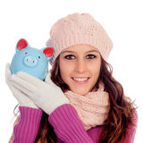 Happy girl with a money-box Royalty Free Stock Photo