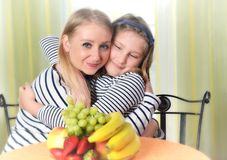 Happy girl and mother using a laptop. Stock Photos