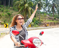 Happy girl on a motorbike Stock Images