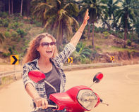 Happy girl on a motorbike Royalty Free Stock Photo