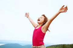 Happy girl on the mountain top. Funny little  happy girl on the mountain top. children outdoors. inspiration Stock Image