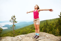 Happy girl on the mountain top Royalty Free Stock Images