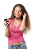 Happy girl with music player Stock Images