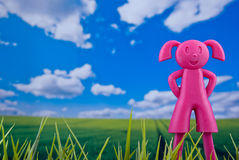 Happy girl in natural background. Happy purple girl puppet in natural background concept Stock Image