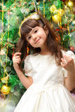 Happy girl near the Christmas tree Royalty Free Stock Images